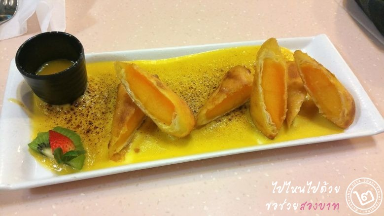 Deep fried mango spring roll with mango sabayon